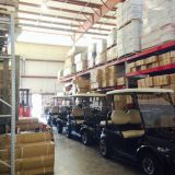 Stock room full of Golf Carts, Party Tents, Mini Motorsports, Motorcycle Trike Kits, and Camper Trailers.